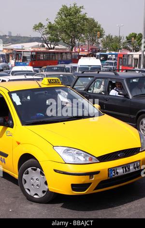 Istanbul Turkey yellow taxi cab taksi stuck in rush hour traffic jam - Stock Photo