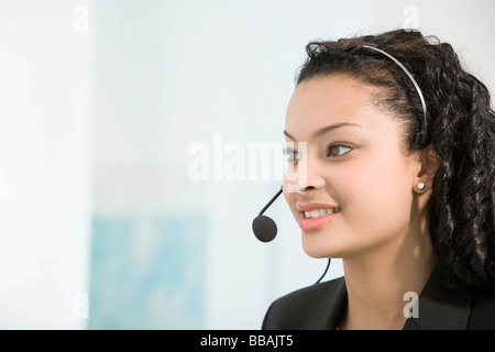 A telephone operator talking into a mic - Stock Photo