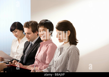 A line of applicants for a job - Stock Photo