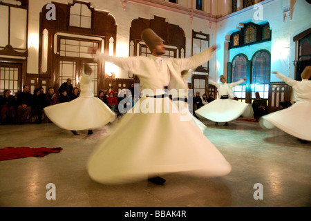 Performance by Whirling Dervishes of the Galata Mevlevi Lodge Sultanahmet Istanbul Turkey (c) Marc Jackson Photography - Stock Photo