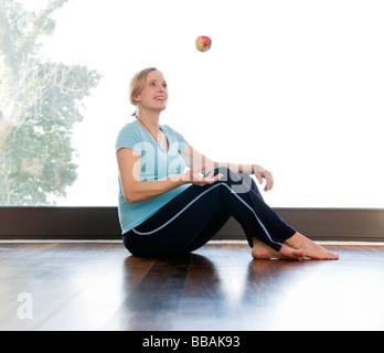 pregnant woman juggling apple - Stock Photo