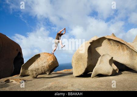 Tourist at the wind eroded landscape of Remarkable Rocks on Kangaroo Island, South Australia, AUSTRALIA - Stock Photo
