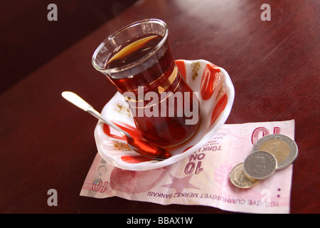 Turkey Turkish glass of hot tea the national drink known as Cay in Istanbul cafe - Stock Photo