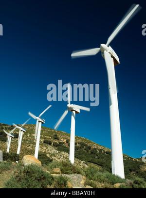 Wind turbines against stormy sky - Stock Photo