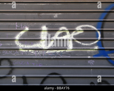 ciao graffiti painted on old garage door wall - Stock Photo