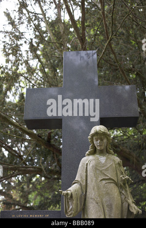 cross and statue - Stock Photo