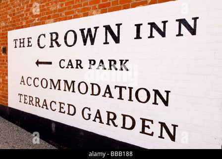 A sign at the crown inn free house pub in Westleton,Suffolk,Uk pointing to the car park and accommodation - Stock Photo
