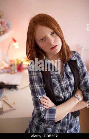 Teenage girl looking cross - Stock Photo