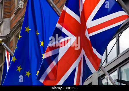 british and european union flags flying together - Stock Photo