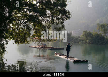 Man on raft in mountain area; - Stock Photo