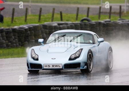 TVR Sagaris on wet track - Stock Photo