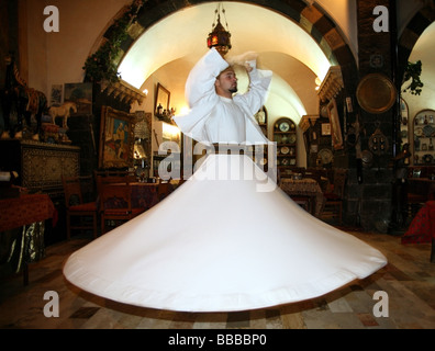 Sufi dancer or whirling dervish at a traditional restaurant Damascus - Stock Photo