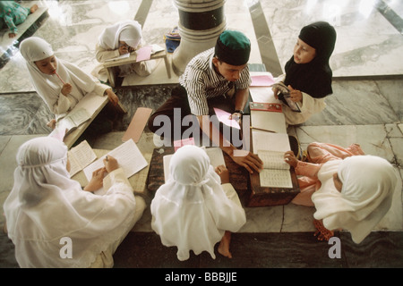Indonesia, Aceh, Banda Aceh, students meet in small groups to learn the Koran with a tutor at the Baiturrahman Great - Stock Photo