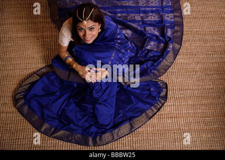Indian woman wearing traditional wedding jewelry - Stock Photo