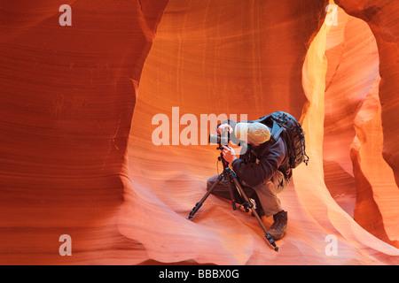 Photographer in Lower Antelope Canyon near Page Arizona - Stock Photo