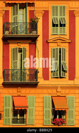 Typical French windows on residential building near the port in Nice France - Stock Photo