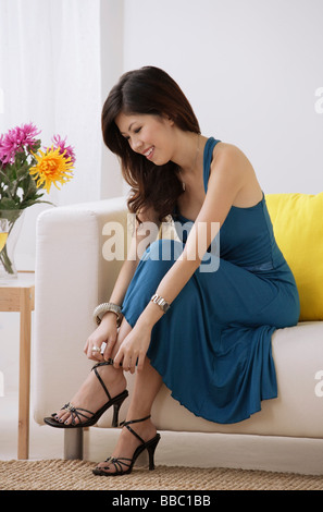 Woman putting on high heels Stock Photo, Royalty Free ...