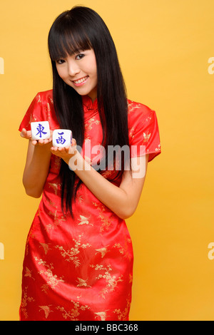 Young woman holding chinese dice meaning