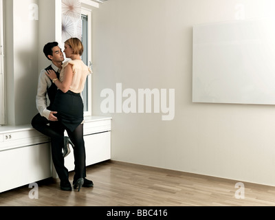 Couple caressing in office - Stock Photo