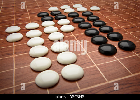 Counters and board for the Chinese board game Go, sometimes referred to as Chinese checkers. - Stock Photo