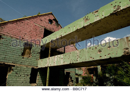 Exterior of a house shows shrapnel damage from the 1992-95 war in Sarajevo capital of  Bosnia Herzegovina - Stock Photo
