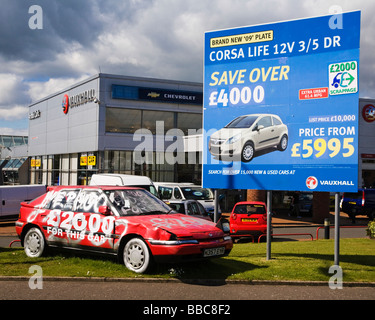an old beat up car on a garage forecourt advertising the 2000 government scrapage scheme