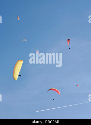 Paragliding in blue skies - Stock Photo