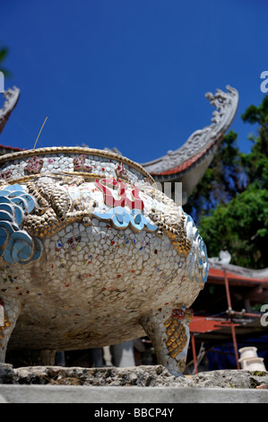 Mosaic covered incense urn. Ta Cu mountain, Binh Thuan Province, Vietnam - Stock Photo