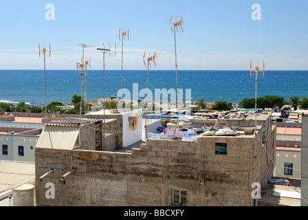 The antennas and clotheslines on the rooftop of a house in small coastal village of Arguineguin, Gran Canaria, Canary - Stock Photo