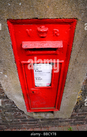 Old victorian in the wall post box - Stock Photo