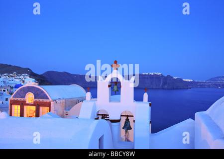 Oia village on Santorini island Greece at dusk - Stock Photo