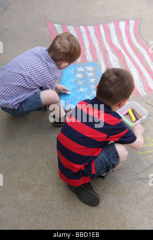 Two young boys draw American flag on sidewalk - Stock Photo