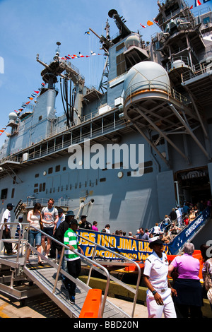 Visitors to the military assult ship USS Iwo Jima LHD 7 in the New York City harbor during a weekend of Fleet Week - Stock Photo
