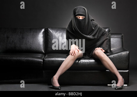 Arabic woman on a sofa - Stock Photo