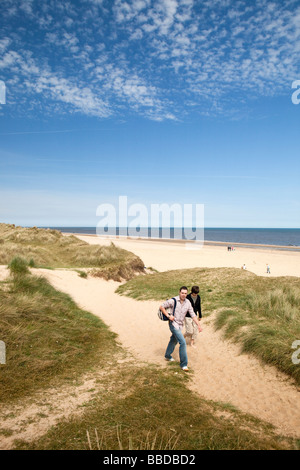 UK England Norfolk Winterton on Sea beach visitors in the sand dunes - Stock Photo