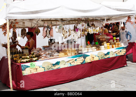 Meat and cheese stall at a weekly market in Genoa,Italy - Stock Photo