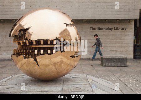 Sphere within a Sphere Sculpture by italian sculptor Arnaldo Pomodoro outside Berkeley Library Trinity College Dublin - Stock Photo