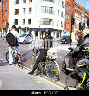 Cyclists queued up at traffic lights at the junction of Clerkenwell Road and  Farringdon Road in London England - Stock Photo