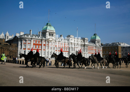 Household Cavalry - Blues and Royals - leave Horse Guards Parade after completing the Changing the Guard, Whitehall, - Stock Photo
