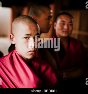 Three young Bhutanese Monks - Punakha Dzong, Bhutan - Stock Photo
