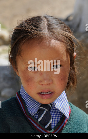 Ladakhi elementary school girl in uniform in a village at 4000m above sea level near Khalsar, Khargongla Pass, Ladakh, - Stock Photo