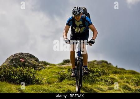 Mountain biker, Alpbachtal, North Tyrol, Austria, Europe - Stock Photo
