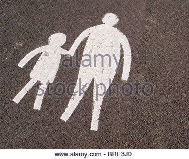 Mother and child markings on a  Path for pedestrians to walk safely on the road - Stock Photo
