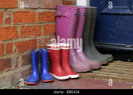 Four Pairs of Wellington Boots on a Doorstep - Stock Photo
