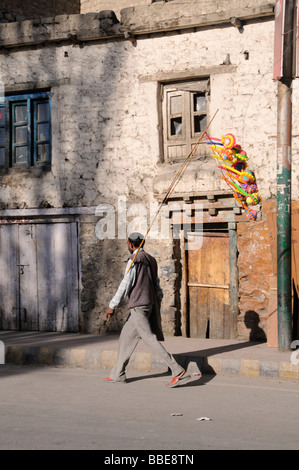 Indian balloon seller in Leh, Ladakh, Northern India, the Himalayas, Asia - Stock Photo