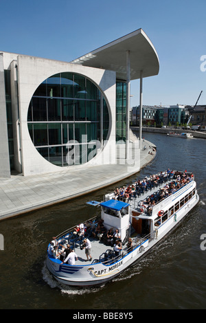 Tourist boat on the Spree River at the Marie-Elisabeth-Lueders House in Berlin, Germany, Europe - Stock Photo