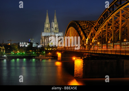 Hohenzollern bridge and Cologne Cathedral by night, North Rhine-Westphalia, Germany, Europe - Stock Photo