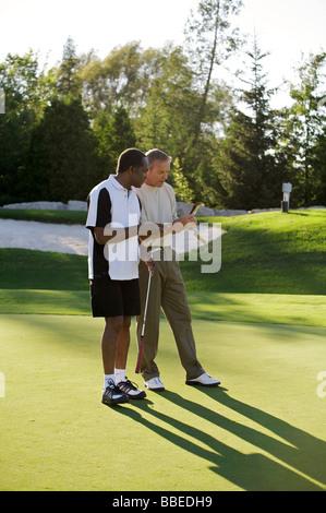 Men Playing Golf, Burlington, Ontario, Canada - Stock Photo