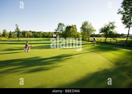 Couple Golfing, Burlington, Ontario, Canada - Stock Photo