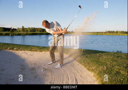 Man Golfing, Burlington, Ontario, Canada - Stock Photo